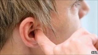 Finger in ear