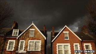 Houses under dark skies