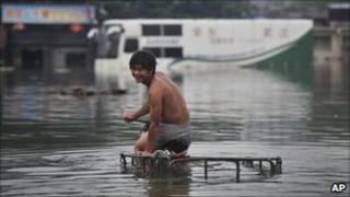 Man in flooded Wuhan, 23/07