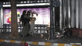 Police inspect the site of an explosion at a bus stop in Bangkok (25 July 2010)