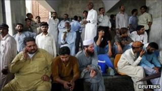 Relatives of the victims gather at the Pakistan Institute of Medical Sciences Hospital in Islamabad