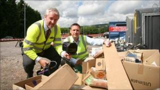 (Left-to-right) Kieran Madden, from SmartWater Technologies Ltd, and Torfaen council environmental officer Richard Marshall at a flytipping site