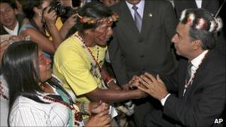 Ecuador's vice president Lenin Moreno shaking hands with indigenous representatives