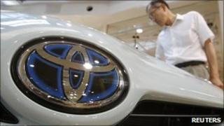 A visitor looks at a Toyota Prius
