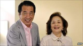 Naoto Kan and his wife, Nobuko, vote in upper house elections in Tokyo on 11 July 2010
