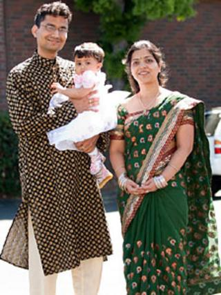 Nidhi Agarwal with her husband and daughter