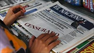"A woman buys a copy of El Nacional, whose front page carried white boxes with the words ""censored"" written in red (18 August 2010)"