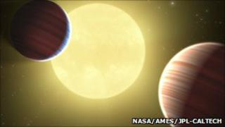 An artist's impression of Kepler-9b and 9c (NASA/Ames/JPL-Caltech)