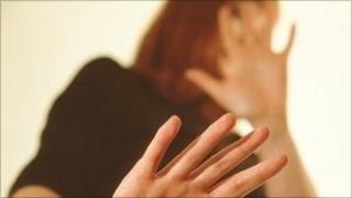 Woman shielding face