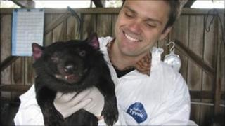 File image of researcher Alex Kreiss holding Cedric in February 2008