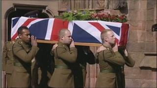 Darren Foster's coffin is carried from the cathedral