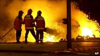 Spanish fireman extinguish burning cars after a car bomb exploded in the Basque regional capital of Vitoria, Spain in the early hours of Monday, Oct 1, 2001
