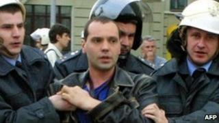 Oleg Bebenin being detained by Belarussian police in an undated photo