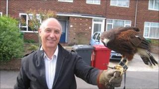 Graham Mitchell, from the council, with George the falcon