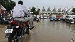 Flooding outside the Jawaharlal Nehru stadium, one of the main Commonwealth Games venues