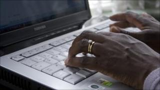 Woman typing on laptop computer