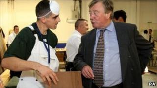 A prisoner talking to Justice Secretary Ken Clarke