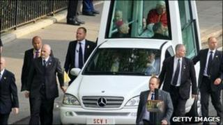Pope Benedict and security guards