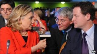 Nick Clegg chatting with US Secretary of State Hilary Clinton and British Secretary of State for International Development Andrew Mitchell