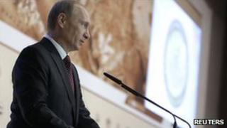 Russian Prime Minister Vladimir Putin addresses the conference on the Arctic in Moscow, 23