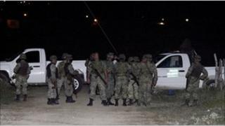 Soldiers guard the crime scene where Prisciliano Rodriguez was killed