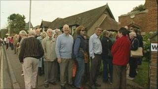 People queuing at polling station