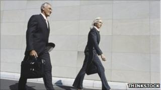 Two colleagues walking outside