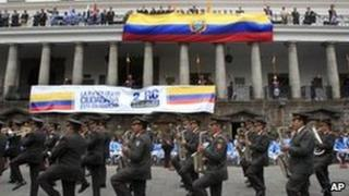 A military band marches past the government palace on 4 October