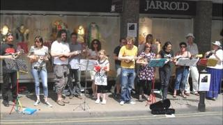 Members of the Norwich Ukulele Society in the city centre raising money for charity