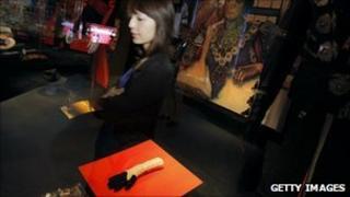 A woman surveys Michael Jackson memorabilia at the Hollywood Legends auction