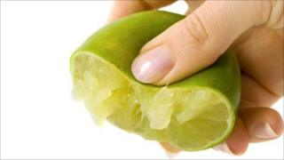 Lime being squeezed
