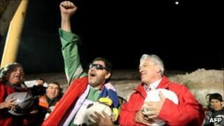 Chilean miner Luis Urzua celebrates with Chile's president Sebastian Pinera
