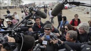 Miner Juan Carlos Aguilar returns to the San Jose amid a media scrum (17 Oct 2010)