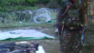 Picture released by Global Tamil Forum apparently shows a Sri Lankan soldier next to bodies