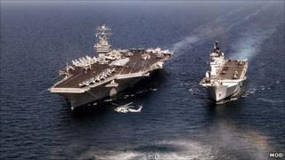 A current US carrier against a current UK one (HMS Illustrious)