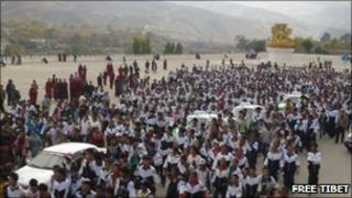 Students marching to centre of Rongwo Town at the gate of Rongwo Monastery 19 October