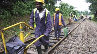 Labourers work to rebuild a railway outside Monrovia (September 2010)