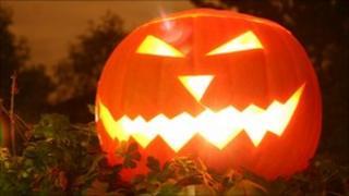 A pumpkin carved for Halloween to form a Jack-o-lantern