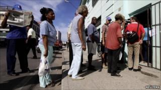 People queue to buy a copy of the Official Gazette in Havana