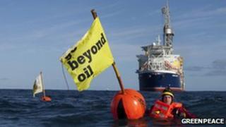 An environmentalist halts the progress of the Stena Carron drilling ship
