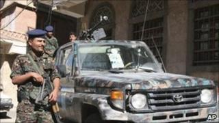 Yemeni policemen outside the state security court in Sanaa,Yemen