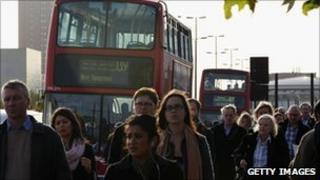 People walking beside buses