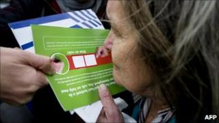 A woman smells a marijuana-scented card in Rotterdam on 8 November 2010
