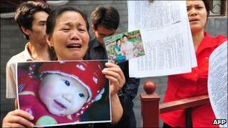 A grieving woman protests outside the Ministry of Health in Beijing. File photo