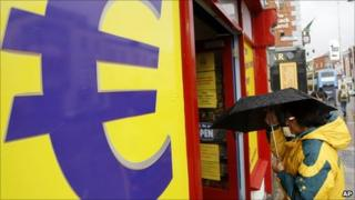 A woman enters a euro discount store in south Dublin, Ireland