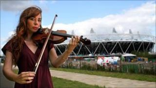 Musician outside the Olympic Stadium in east London