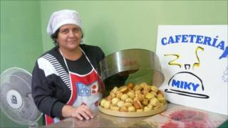 Mirkeyis Calvo shows off some of her cafe's food