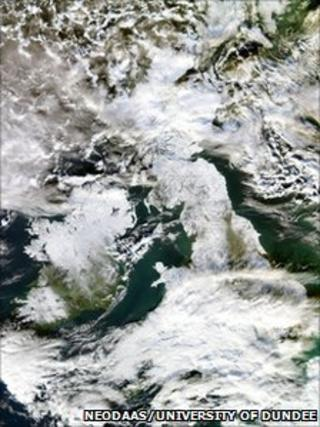 A satellite image showing Britain wrapped in a blanket of snow.
