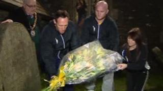 Mark Taylor and John Hartson place flowers on Guto Nyth Bran's grave