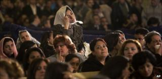 Christian women attend the Christmas Eve Mass at the Coptic cathedral in Cairo